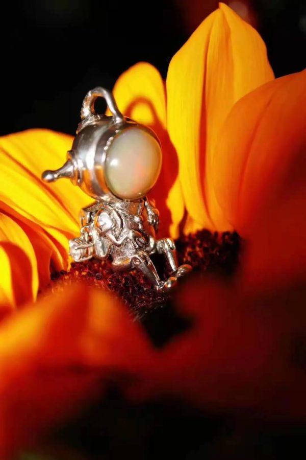 一起来聊聊绝美宝石——欧泊石,欧泊的魔幻色彩哪里来?-菩心晶舍